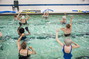 Seniors exercising in water