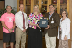 Pictured (L-R): Brandon Harbinson, Arndt Athletic Director, Marcus Osborne LAT, ATC, CVMC's Director of Sports Medicine, Angela Williams, Arndt Principal, Carl Becker, RT(R), (CV), Director, Angiography Services at CVMC, and Margaret Sides, Arndt School Nurse.