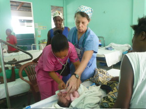 Bobbi Kimsey assists with newborn exam in Haiti